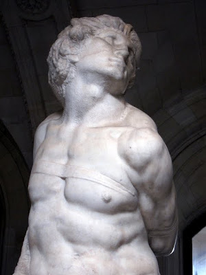 Michelangelo's The Slave on a private tour of the Louvre museum in Paris France