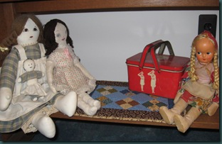 dolls and quilt