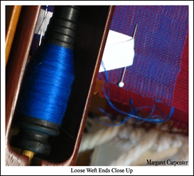 loose weft ends close up