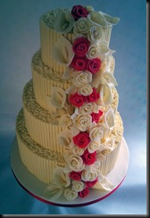4 tier Chclate curls and Red roses