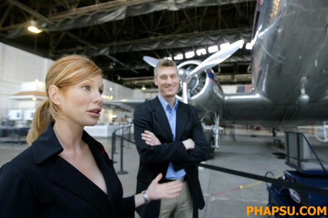 080325 - Atlanta, GA. -  Katherine Lee in the Delta Museum near their headquarters in Hapeville today, 3/25/08. She has become somewhat of a celebrity because of a new Delta safety video. Global product development manager Chris Babb is on right. He was a creative force behind the video.  Louie Favorite / AJC