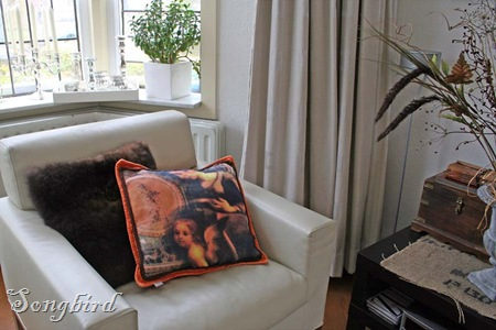 Corner with orange pillow