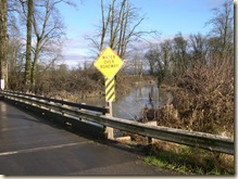 Waters over troubled bridge