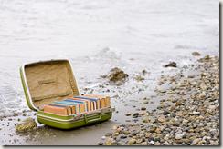 Reading at the beach, av Joseph Robertson på Flickr. Lisens: CC by-nc-sa