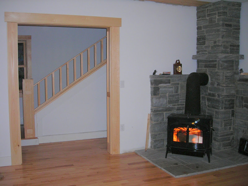 wood stove and masonry surround.
