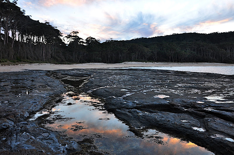 sunset reflected in tidal pool