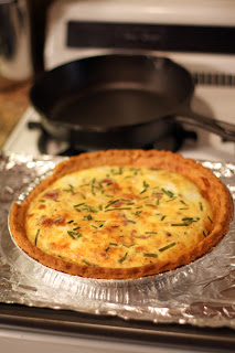 picture of quiche having emerged golden from the oven