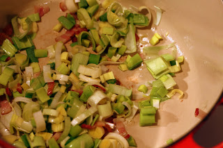 picture of leeks added and being sauteed