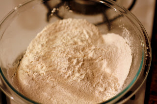 In a separate bowl, sift together flour, baking powder, baking soda, and salt