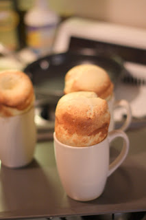 picture of freshly baked popovers in coffee cups