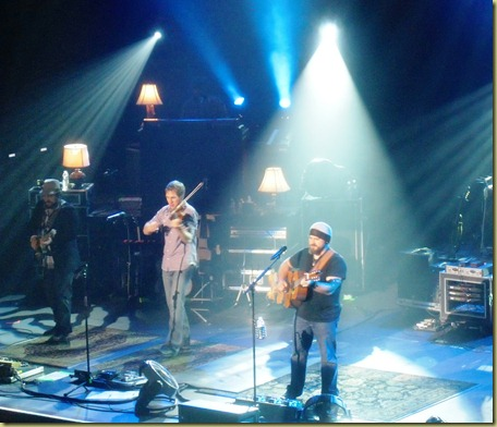 Zac Brown and his band playing on stage.