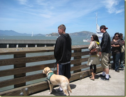 James and Reyna looking over the edge of the pier at the Sea Lions.