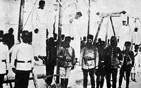 Ottoman soldiers posing in front of Armenians they are hanged in a open place, picture taken in Alep in 1915