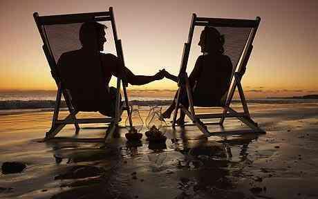 Couple examination nightfall on a beach