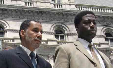 New York administrator David Paterson, left, with help David Johnson