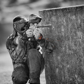 Hit! You're out! by Eljay Peña - Sports & Fitness Other Sports ( orange, guns, paintball, black and white, outdoors, sports )