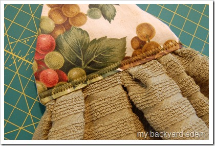 Stitch topper to towel
