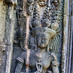 "This Thommanon Devata (sacred female image) is also holding three mysterious rod-like objects with the ""devata mudra."" She is holding them with her left hand, and her stomach is unmarked (the previous devata holds them with her right hand and has a marked stomach). Siem Reap, Cambodia http://www.Devata.org"
