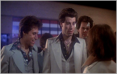 saturday-night-fever_john-travolta_white-suit-outside-club-bmp