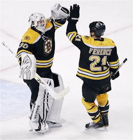 Andrew Ference congratulates Tim Thomas on his shutout against the Devils
