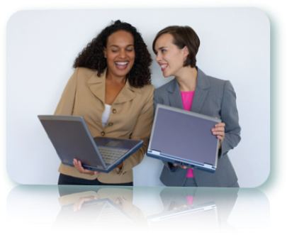 Two women smiling, laughing and holding laptops.