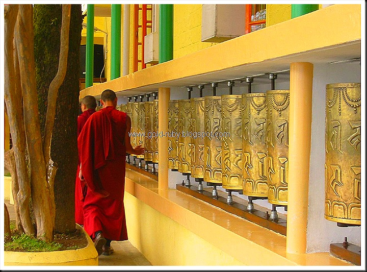 Prayer_Wheels_at_Tsuglagkhang_Temple,_McLeod_Ganj