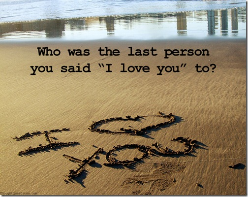 """I love you"" written on a beach"