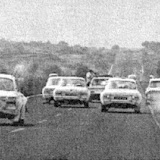 Paddy Hopkirk have a dice with the pack on the drive into the Aztec Stadium in Mexico city - by this time the results had been decided.