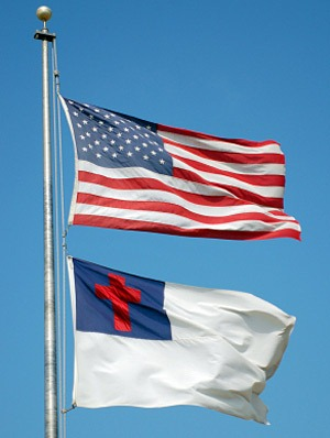 Image of the American flag and the Christian flag flown on the same flag pole.