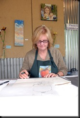 Paula Amerine at work on a drawing.