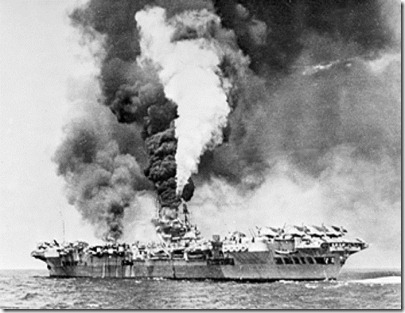 HMS Victorious on fire after being struck by three kamikazes at the Battle of Okinawa.  Planes could take off an hour later.