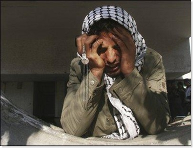 img_b1ed8caee5_woman_crying_in_gaza_ap