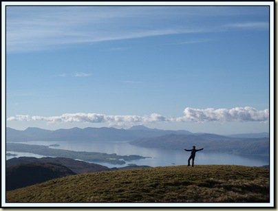 Sue enjoys the wide summit of Fraochaidh