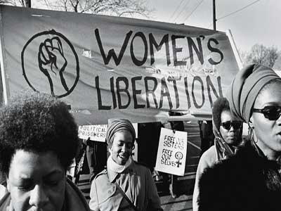 A group of women, under a 'Women's Liberation' banner, march in support of the Black Panther Party, New Haven, Connecticut, November 1969. (Photo by David Fenton/Getty Images)