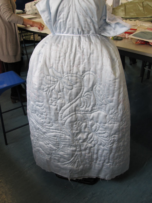 Draping the quilted petticoat on the stand