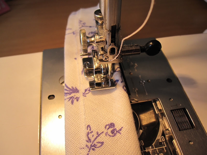 Using a zipper foot to sew close to the cord