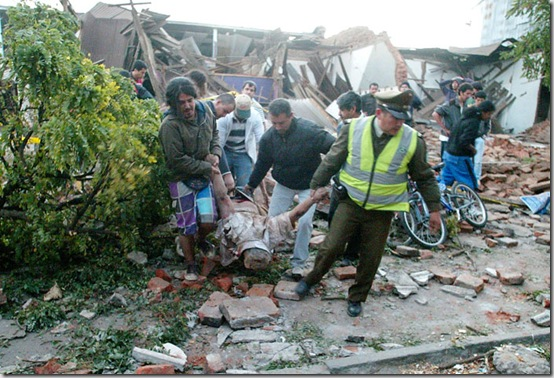 A police officer and residents,  carry a body from a destroyed house in Talca, Chile, some 275 kilometers south of Santiago, Saturday, Feb. 27, 2010 after an 8.8-magnitude struck central Chile.  The quake hit 200 miles (325 kilometers) southwest of the capital and the epicenter was just 70 miles (115 kilometers) from Concepcion,  Chile's second-largest city.(AP Photo/Sebastian Martinez)