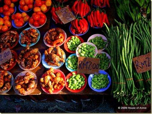 turmeric, tomatoes, chiles, long beans, petai