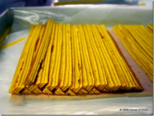 yellow triangular strips for sarawak layer cake design - copyright house of annie