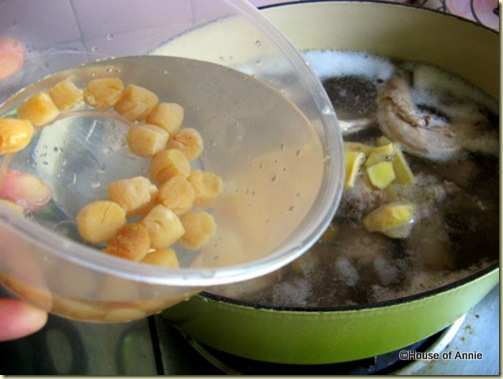 adding scallops to winter melon soup