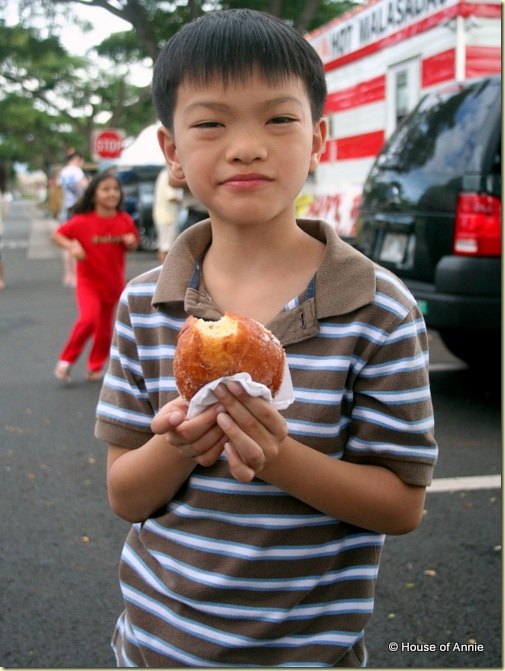 Daniel eating a malasada
