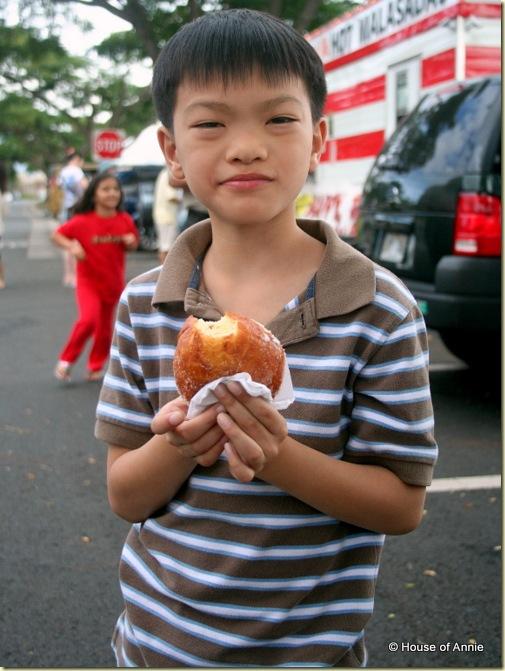 Daniel eating a malasada