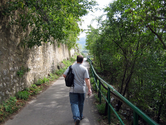 Carey walking along a fortified hills wall