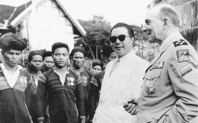 Ban Me Thoot, May 1950. General Jean de Lattre de Tassigny (right), commander of French troops in Indochina, and Bao Dai, the former emperor of Vietnam, visit in Ban Me Thoot with the Vietnamese Mois people, who were fghting the communist-dominated Vietminh forces.