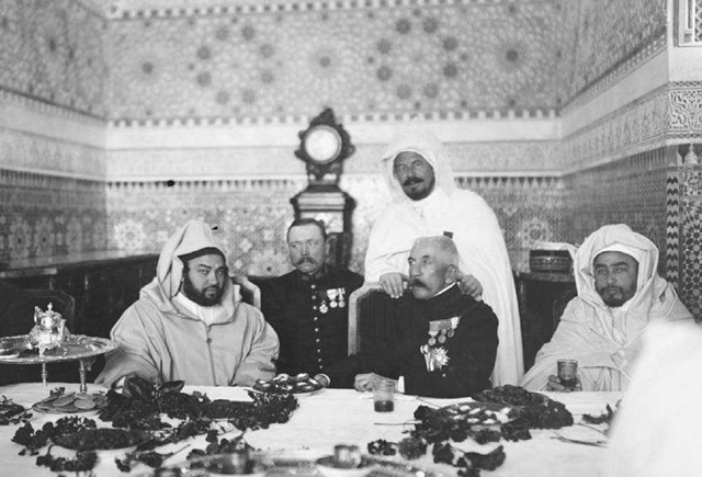 Louis Lyautey with Sultan Moulay Youssef, Circa 1925• Louis Hubert Gonzalve Lyautey, the French military leader and resident-general of Morocco from 1912 to 1925, dines with Moulay Youssef, sultan of Morocco.