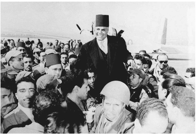 Habib Bourguiba, March 23, 1956. Triumphant Tunisians carry nationalist leader Habib Bourguiba upon his return from Paris after the signing of the Franco-Tunisian Protocol proclaiming the independence of the protectorate. Bourguiba was elected president of independent Tunisia in 1957.