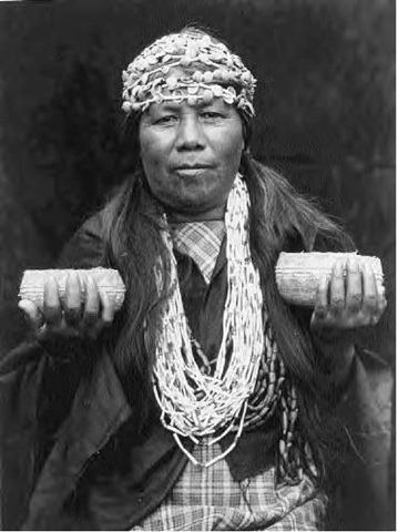 Native American wise women like this Athapaskan Hupa female shaman often held the collective medical wisdom of their tribe regarding birth control practices.