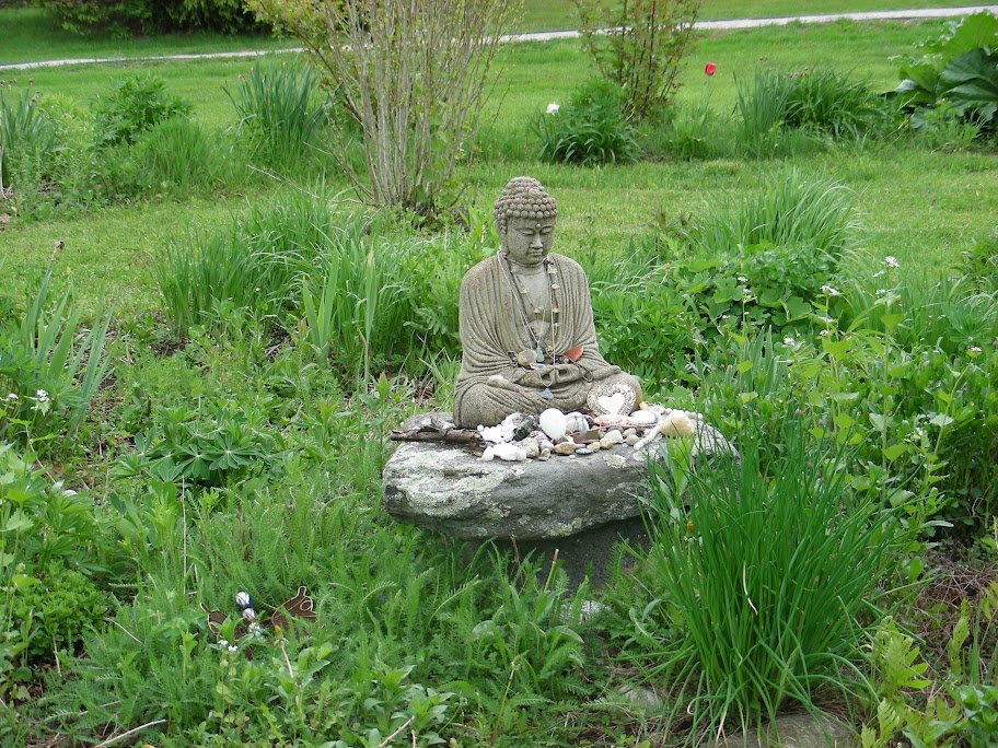 Beautiful Stone Buddha Garden Statue Sitting On A Natural Rock Plinth