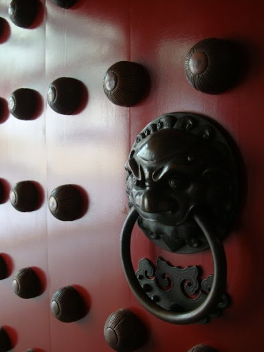 creepy doorknob, creepy door, goth door, buddhist door