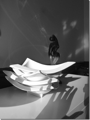 white dishes and tt sculpture